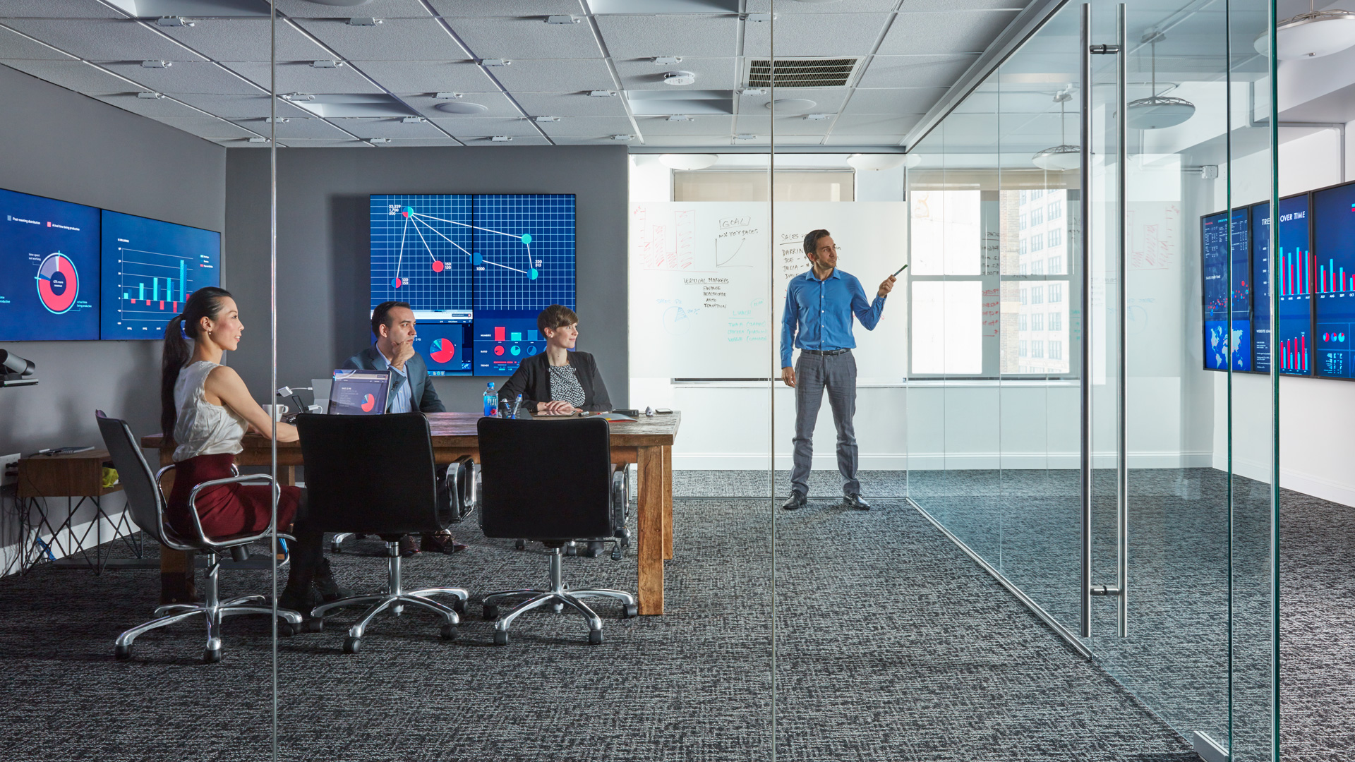 Mezzanine from Oblong Industries: a conference room with many high resolution screens and points of input