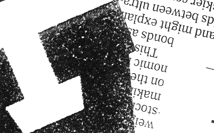 Photocopier collage showing the bottom of a capital letter A, upside down, with smaller text overlaid on top